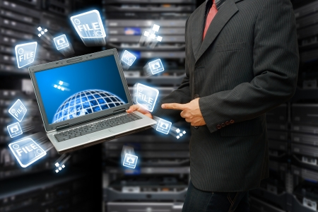 internet terminals: Programmer in data center room and keep the file system from the world Stock Photo