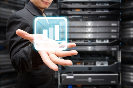 Programmer in data center room and bar graph on hand