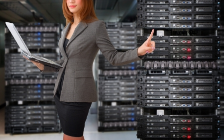 data backup: Programmer take control the digital file in data center room