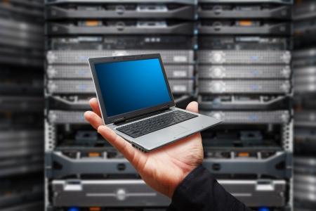 Laptop in data center room Standard-Bild