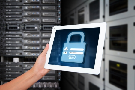 Programmer in data center room and Login screen activated for security Imagens - 16861159