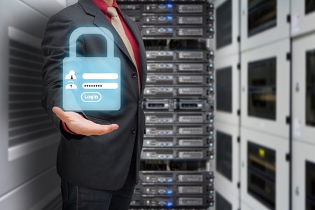 data protection: Programmer in data center room and Login screen activated for security Stock Photo