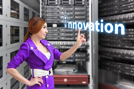 Programmer and innovation word in data center room photo