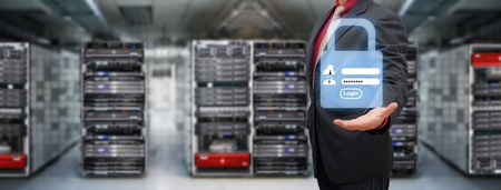 web server: Programmer in data center room and Login screen activated for security Stock Photo