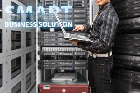 Programmer in data center room photo