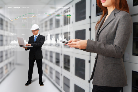 Programmers in data center room photo
