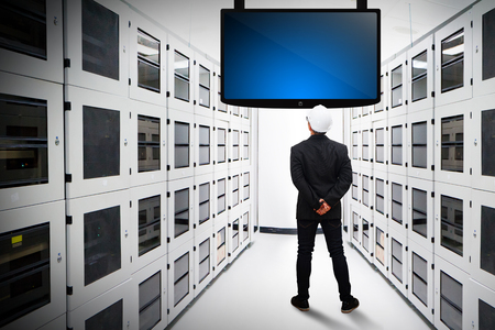 business solutions: Programmers in data center room Stock Photo