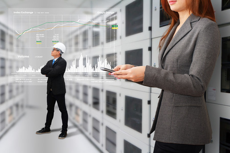 e systems: Programmers in data center room Stock Photo