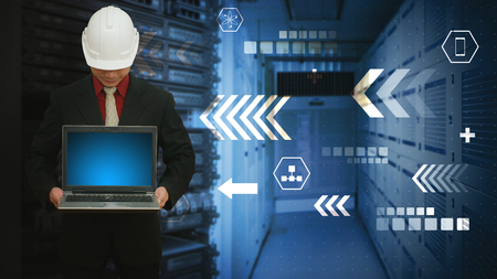 Programmer in data center room for networking computing concept photo