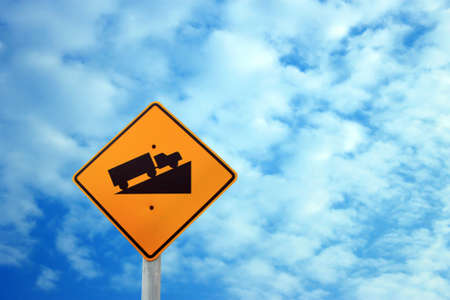steep: Warning sign steep on the clouds and blue sky background  Stock Photo