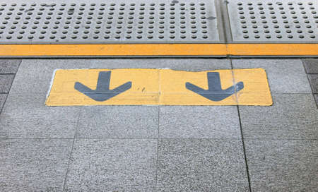 wayout: Exit arrow sign on the sky-train station  Stock Photo