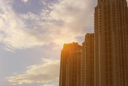 Condominium buildings sun silhouette photo