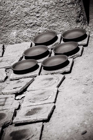 Clay plates, drying in the sun before baking photo