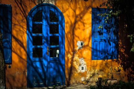 Closed blue windows and blue door