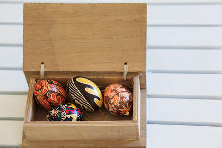 Easter eggs in a wooden box photo