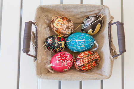 Bunch of colorful Easter eggs in a basket Stock Photo - 18961454