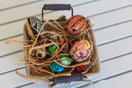 Bunch of colorful Easter eggs in a basket photo