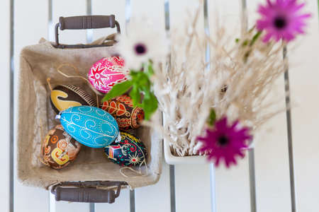 Bunch of colorful Easter eggs in a basket Stock Photo - 18961446