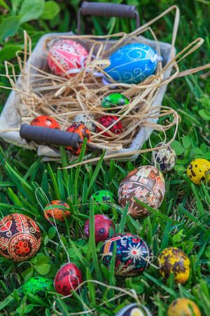 Diverse Easter eggs in a basket, placed on a grass Stock Photo - 18961457