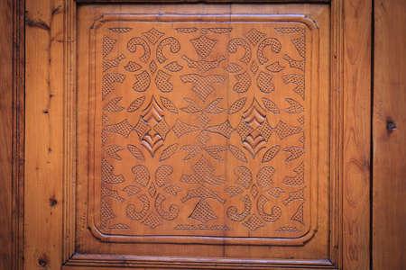 Brown wood-carving door