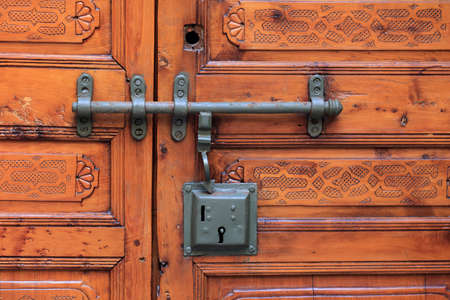 Old rustic door with lock and handle photo