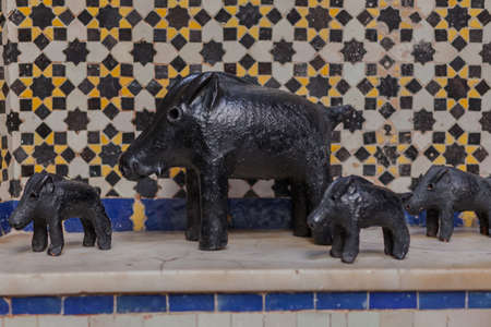 Decorative small wild pigs, arranged in a row Stock Photo