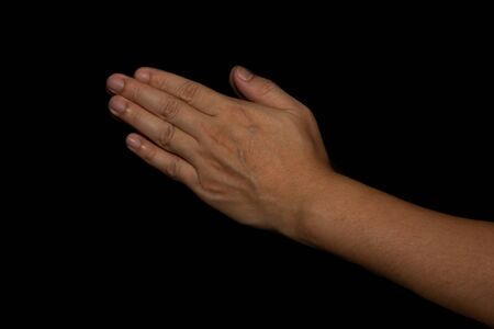 The man whose hand is praying on the black background