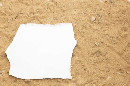 Blank paper concept for text on a sand background