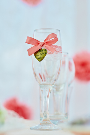 Wedding ceremony table with decored wineglass in marine style in coral color Stock Photo