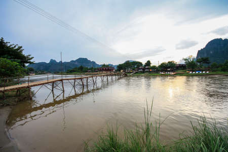 guesthouse: Wooden bridge over river nam song to riverside guesthouse, Vang vieng, Laos