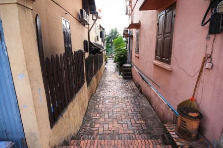 pra: Small brick passage in Luang Pra Bang,Laos