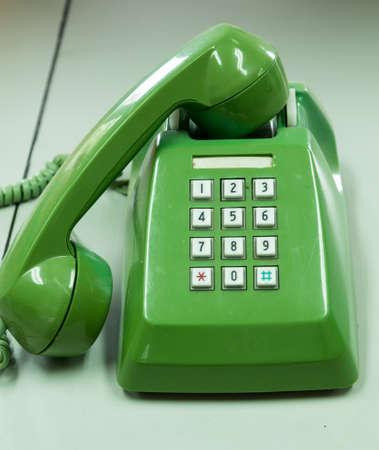 telephonic: Old green telephone