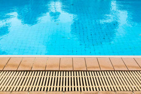poolside: Poolside and drainage ditches ,blue pool water