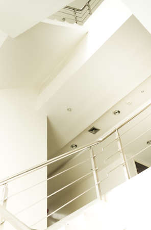 stairwell: Stairwell and  stainless steel handrail in modern office Stock Photo