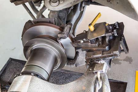 rebuild surface of disc brake by on car brake lathe Stock Photo