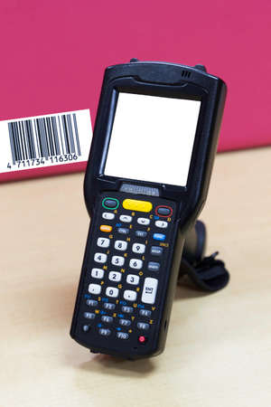 handheld barcode scanner reader with blank screen on table