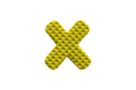 yellow alphabet X made from EVA foam isolated on white background with clipping path Stock Photo