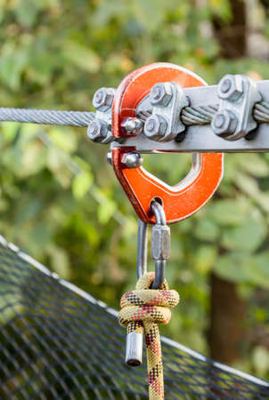 orange safety hook and wire rope for protect on high walkway Stock Photo
