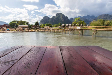 wooden table beside Nam Song river in Vang Vieng, Laos