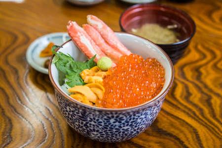 japanese food with fresh uni and ikura on rice