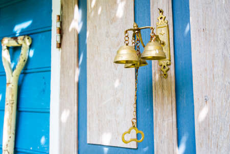 small brass bell on the door