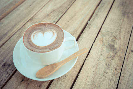 coffe on wood table with wood spoon
