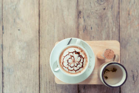 top view of latte art coffe on wood table 写真素材