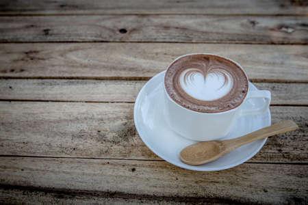 mocha coffe on wood table with wood spoon 写真素材