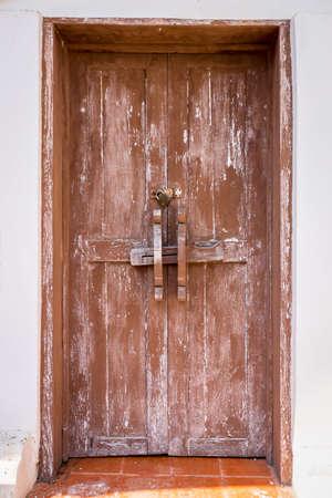old wood door on white wall 写真素材