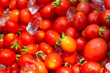 group of fresh red cherry tomato with ice