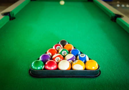 billiard ball on green table