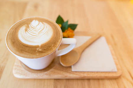 cup of latte coffe on wood table 写真素材