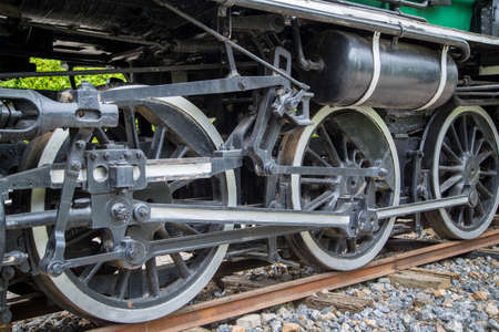 wheel of old steam train close up 写真素材