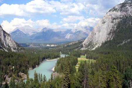 View of the Bow River and the Canadian Rockies next to the Banff Springs golf course. Stock Photo